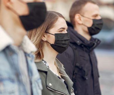 People in the city. Persons in a masks. Coronavirus theme. Friends walks during quarantine.